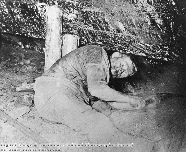Miner working on the coal seam